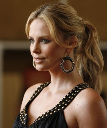 Charlize Theron poses in leather and chains