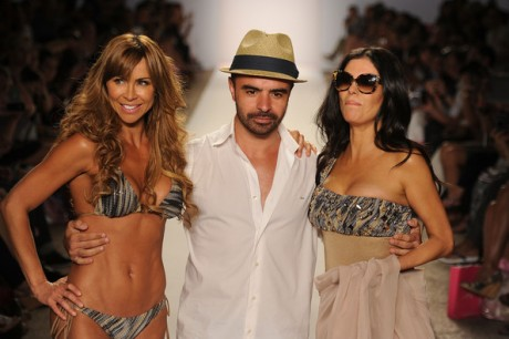 Designer A.Z. Araujo and Adriana de Moura walk the runway