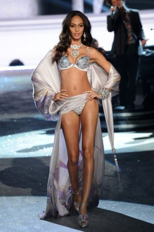 Model Joan Smalls walks the runway during the Victoria's Secret 2012 Fashion Show