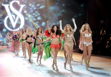 Models Adriana Lima, left, Doutzen Kroes and Candice Swanepoel, right, lead the final runway walk during the 2012 Victoria's Secret Fashion Show
