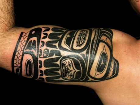 Younger Guys Tribal Arm Tattoo Design for 2012
