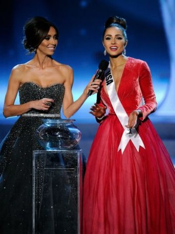 Television personality and pageant co-host Giuliana Rancic (L) looks on as Miss USA 2012, Olivia Culpo