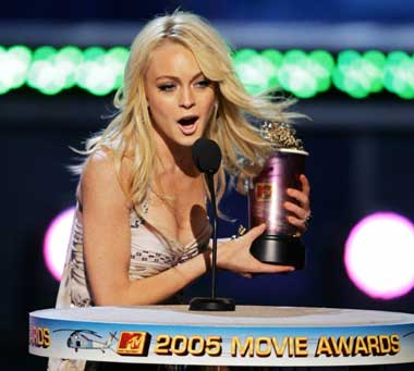 Actress Lindsay Lohan holds her award after winning the Best Female