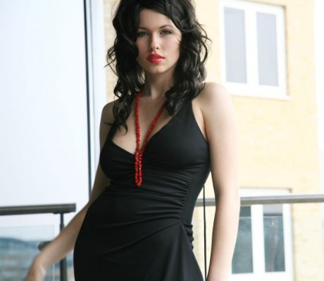 Iga Wyrwal Black Dress with red Jewelery