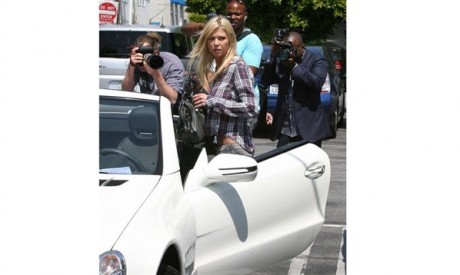 Tara Reid Luxury Car Photo