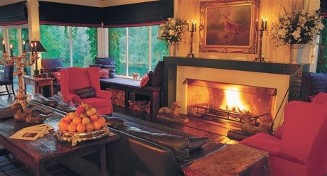 Warm your feet by the fire at Huka Lodge